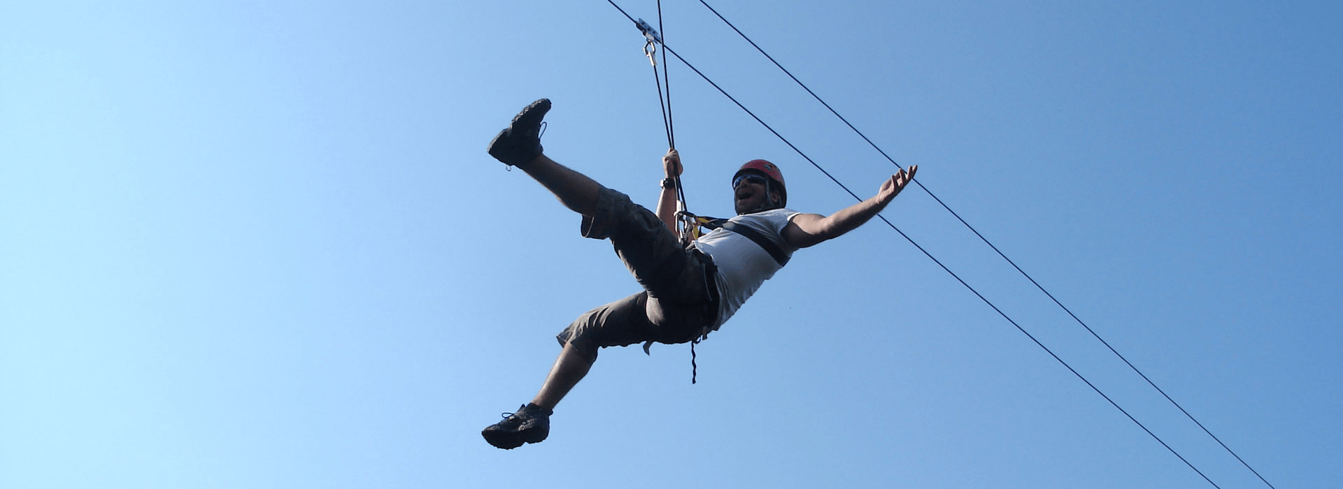 zip lining happy man