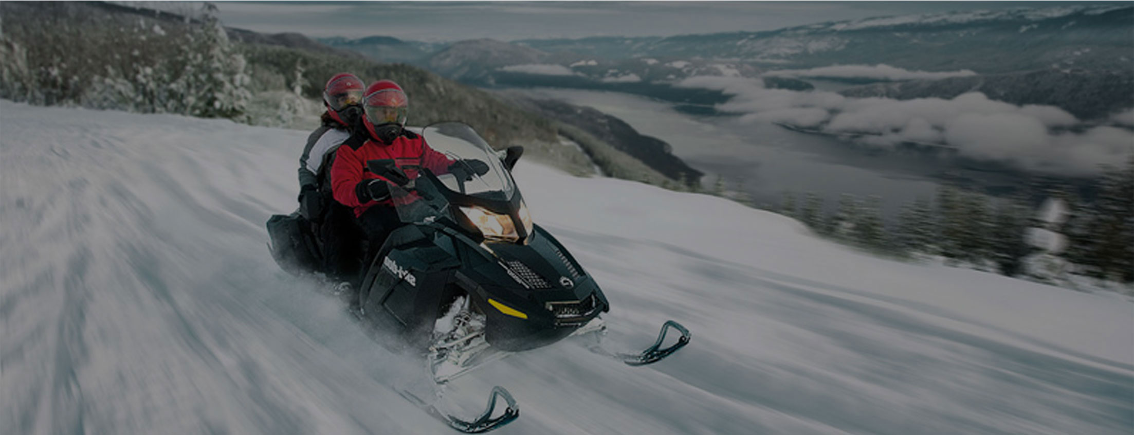 mountain snowmobiling in the winter